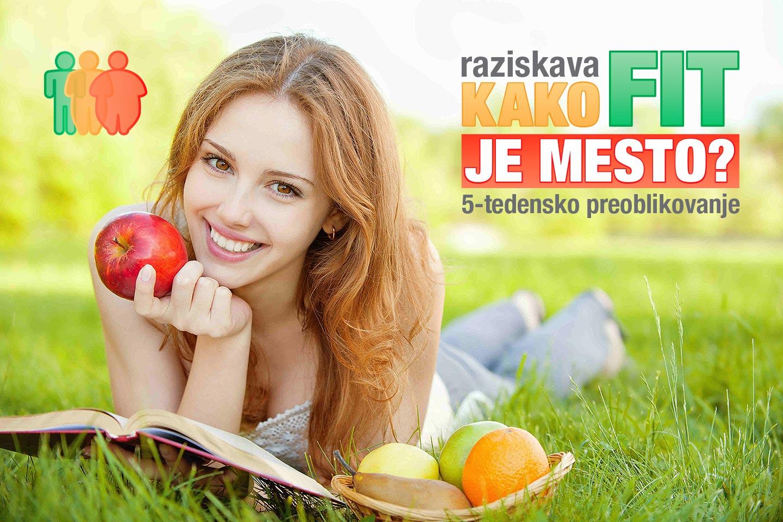 Zenska z jabolkom pod Kako fit je mesto